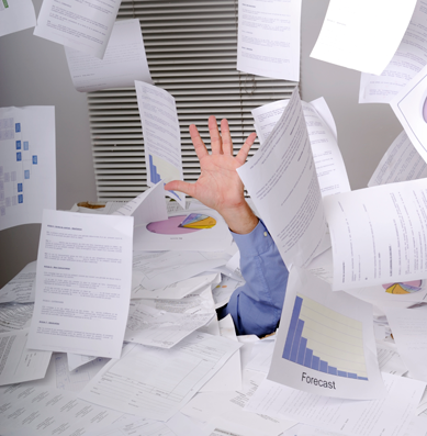 man drowning in files